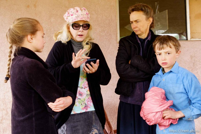Trent Nelson | The Salt Lake Tribune UEP eviction of property at 555 N Lauritzen Ave, Colorado City, AZ, Wednesday May 10, 2017. Christine Marie Katas helps FLDS single mother Liz look for an apartment. Liz's children Joseph and Mary Anne. The FLDS choose to not use the Internet, but will use information that others are able to look up.