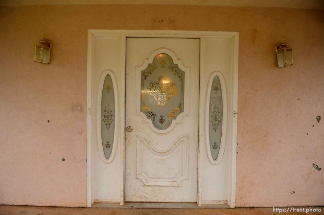 Trent Nelson | The Salt Lake Tribune door at home at 555 N Lauritzen Ave, Colorado City, AZ, Wednesday May 10, 2017. UEP evicted this property shortly after photo was taken.
