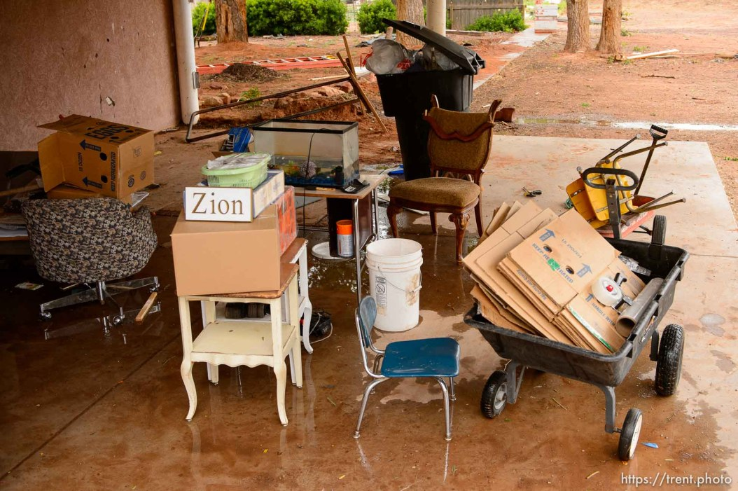 Trent Nelson | The Salt Lake Tribune A small sign reading Zion, a common sight at FLDS homes, sits among a variety of belongings left behind as eviction of the Colorado City, AZ, home looms, Wednesday May 10, 2017. belongings outside