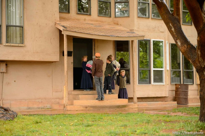 Trent Nelson   The Salt Lake Tribune UEP eviction of property at 345 N Richard St, Colorado City, AZ, Wednesday May 10, 2017. FLDS children walk out of the home.