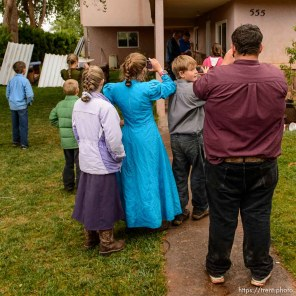 Trent Nelson | The Salt Lake Tribune FLDS children take videos as a locksmith Kelvin Holdaway and Mohave County Constable Mike Hoggard change the locks on a Colorado City, AZ, home that FLDS members had been living in, Wednesday May 10, 2017.