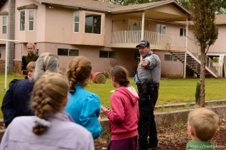 Trent Nelson | The Salt Lake Tribune Colorado City Town Marshal Sam Johnson orders young FLDS children to leave the property of a home being taken overy by the UEP Trust in Colorado City, AZ, Wednesday May 10, 2017.