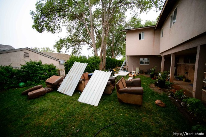 Trent Nelson | The Salt Lake Tribune UEP eviction of property at 555 N Lauritzen Ave, Colorado City, AZ, Wednesday May 10, 2017. belongings in yard, in rain.