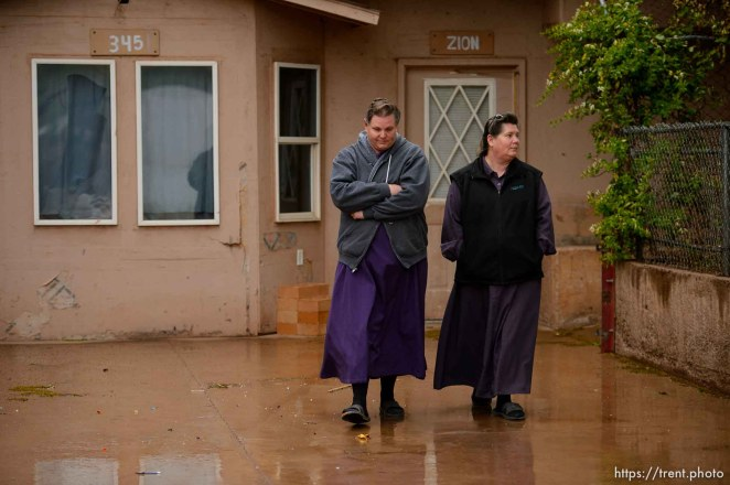 Trent Nelson   The Salt Lake Tribune UEP eviction of property at 345 N Richard St, Colorado City, AZ, Wednesday May 10, 2017. Lydia Bateman, right, leaves her home.