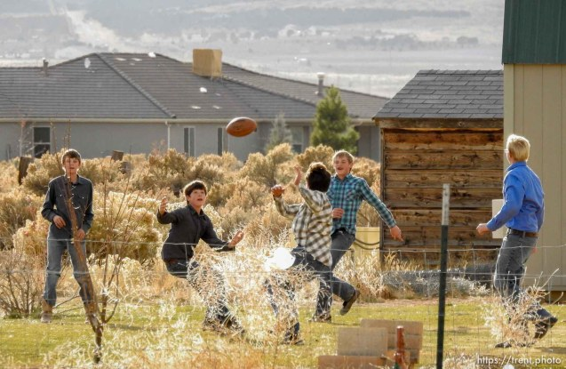 (Trent Nelson | The Salt Lake Tribune) A group of boys in long-sleeved shirts play backyard football at a Cedar City home where members of the polygamous Fundamentalist Church of Jesus Christ of Latter-Day Saints are purported to live, Wednesday November 8, 2017.
