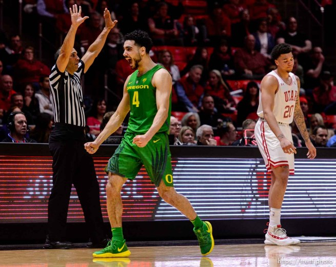 (Trent Nelson | The Salt Lake Tribune) Oregon Ducks guard Ehab Amin (4) celebrates a turnover by Utah Utes forward Timmy Allen (20) as the Utah Utes host the Oregon Ducks, NCAA basketball in Salt Lake City on Thursday Jan. 31, 2019.