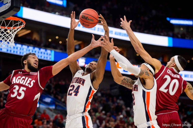 (Trent Nelson | The Salt Lake Tribune) New Mexico State Aggies forward Johnny McCants (35), Auburn Tigers forward Anfernee McLemore (24), Auburn Tigers guard Bryce Brown (2) and New Mexico State Aggies guard Trevelin Queen (20) as Auburn faces New Mexico State in the 2019 NCAA Tournament in Salt Lake City on Thursday March 21, 2019.