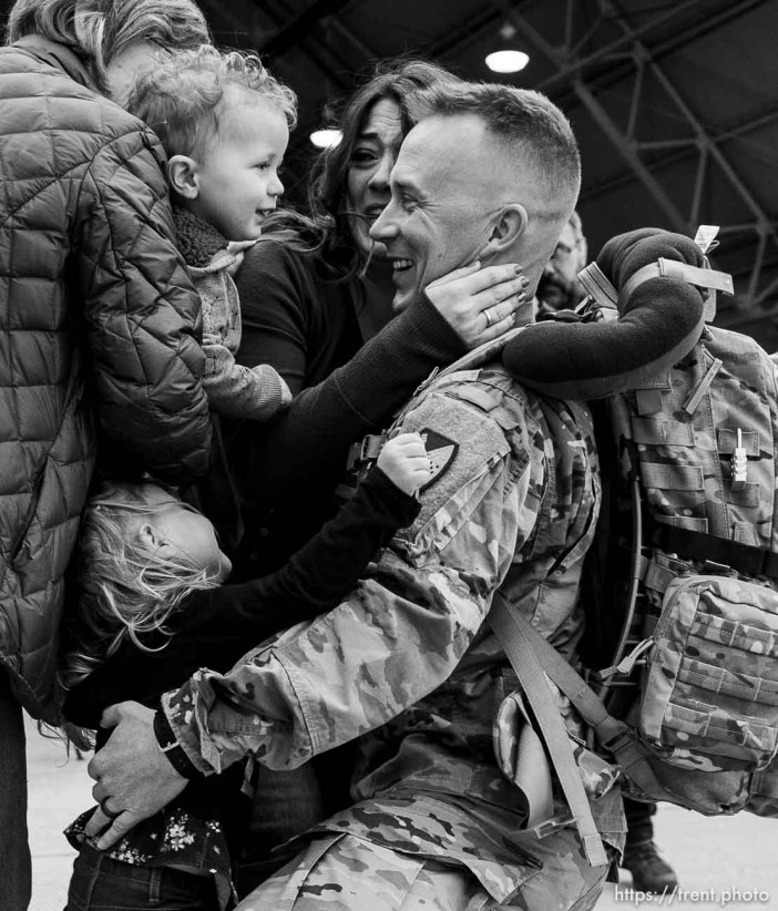 """(Trent Nelson   The Salt Lake Tribune) Staff Sergeant Sean Sullivan is welcomed home by his wife Kim and children Mae and Simon as almost 100 Soldiers from Utah Army National Guard's Echo Battery, 1st Battalion, 145th Field Artillery, """"Big Red"""" return after a 10-month Middle East deployment, on Tuesday April 9, 2019 at Wright Air Base in Salt Lake City. Sullivan's mother Ilean at left."""