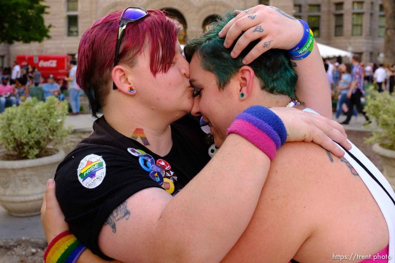 (Trent Nelson | The Salt Lake Tribune) Scha Strasburg and Karrah Watson embracing after getting engaged at the Utah Pride Festival in Salt Lake City on Saturday June 1, 2019.