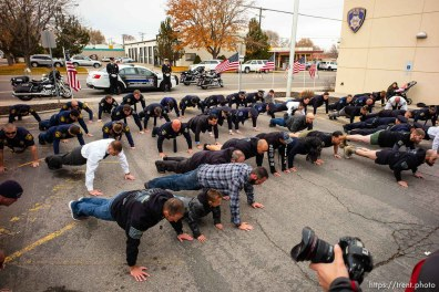 (Trent Nelson | The Salt Lake Tribune) Men do push-ups to honor Officer Romrell at the dedication ceremony of the David P. Romrell Public Safety Building on Sunday Nov. 24, 2019. The building is named after Officer Romrell, who was killed in the line of duty on Nov. 24, 2018 - one year ago.
