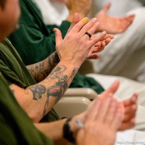 (Trent Nelson | The Salt Lake Tribune) Inmates applaud as Gage King, an inmate at the Utah State Prison, delivers a speech at a meeting of the New Visions Speech Club in the prison's Promontory facility in Draper on Tuesday Dec. 3, 2019.