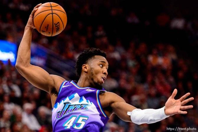 (Trent Nelson   The Salt Lake Tribune) Utah Jazz guard Donovan Mitchell (45) rebounds as the Utah Jazz host the Portland Trail Blazers, NBA basketball in Salt Lake City on Thursday, Dec. 26, 2019.