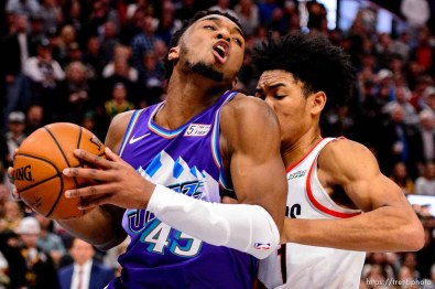 (Trent Nelson | The Salt Lake Tribune) Utah Jazz guard Donovan Mitchell (45) is fouled by Portland Trail Blazers guard Anfernee Simons (1) in the fourth quarter as the Utah Jazz host the Portland Trail Blazers, NBA basketball in Salt Lake City on Thursday, Dec. 26, 2019.