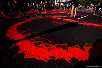 (Trent Nelson | The Salt Lake Tribune) Protesters paint the street red in front of the Salt Lake County District Attorney's office in Salt Lake City on Thursday, July 9, 2020.