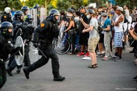 (Trent Nelson | The Salt Lake Tribune) Police push back protesters in Salt Lake City on Thursday, July 9, 2020.