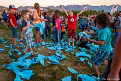 (Trent Nelson | The Salt Lake Tribune) Children rip up a large paper mask at a rally protesting government mask mandates at the State Capitol inSalt Lake City on Saturday, Sept. 5, 2020.