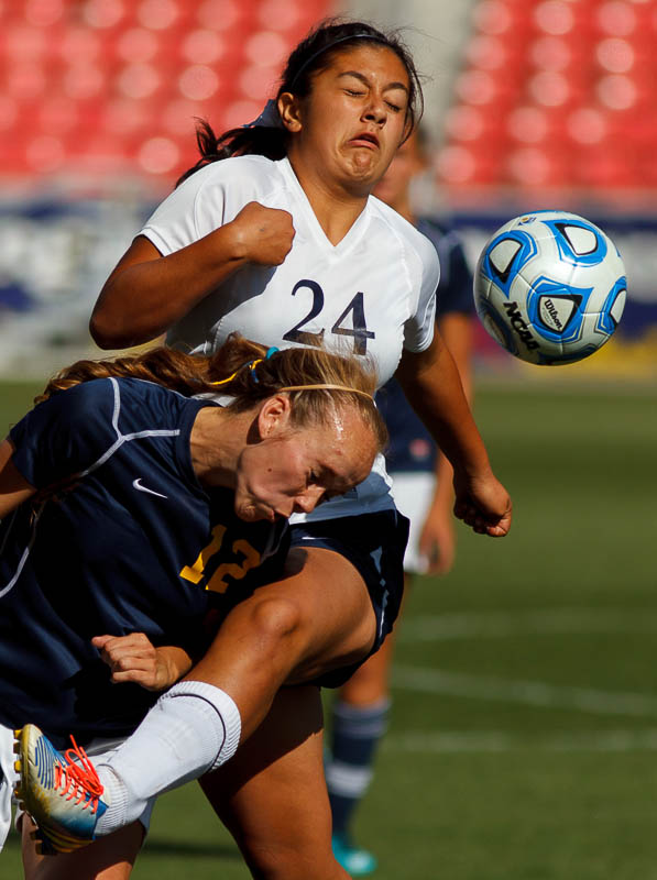 Summit's Allison Gorringe and Waterford's 24 collide as Waterford faces Summit Academy in the 2A high school girls' soccer state championship game at Rio Tinto Stadium in Sandy, Saturday October 26, 2013