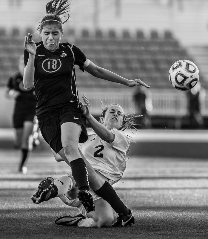 Dixie's Cassidy Gray, defended by Juan Diego's Claire Kolff as Juan Diego faces Dixie in the 3A high school girls' soccer state championship game at Rio Tinto Stadium in Sandy, Saturday October 26, 2013