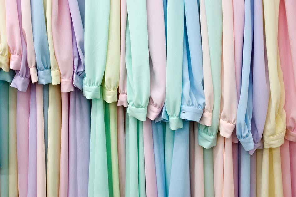 A rack of pastel colored dresses in the sewing shop at the FLDS church\\'s YFZ ranch outside of Eldorado, Texas.