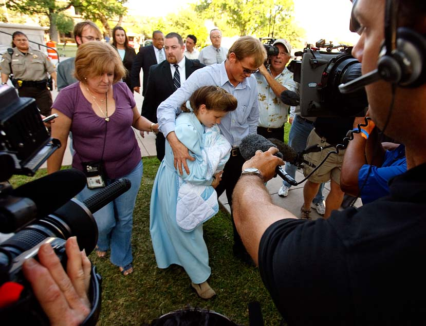 San Angelo, Texas - FLDS member Dan Jessop and his wife Louisa Bradshaw wade through media cameras as they leave the Tom Green County Courthouse after a custody hearing on the status of their newborn son. CPS had refused proof that Bradshaw was an adult until her child was born in state custody, at which point they sought to take custody of the newborn. Bradshaw did her case no good by refusing to answer such seemingly simple questions as who attended her wedding and who else lived in her home.