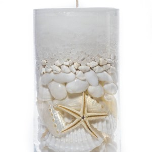 Shell candle in clear vase