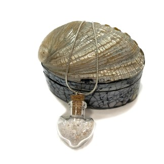 Shell box with glass heart necklace