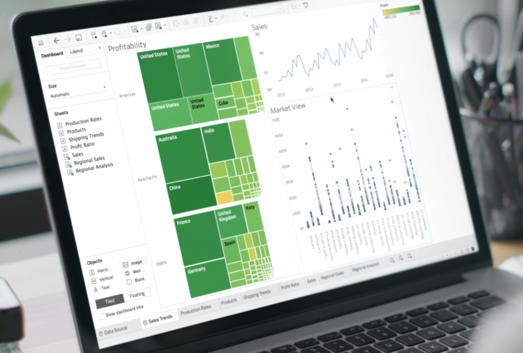 Open computer showing Tableau tool data visualisations