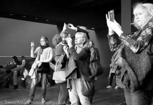 Take Better Photos in Teddington - crowd taking photos with mobile phones