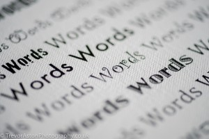 "photograph of ""word"" printed many times"