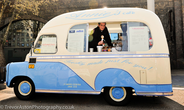 man serving ice cream cone from an ice cream van Trevor Aston Photography