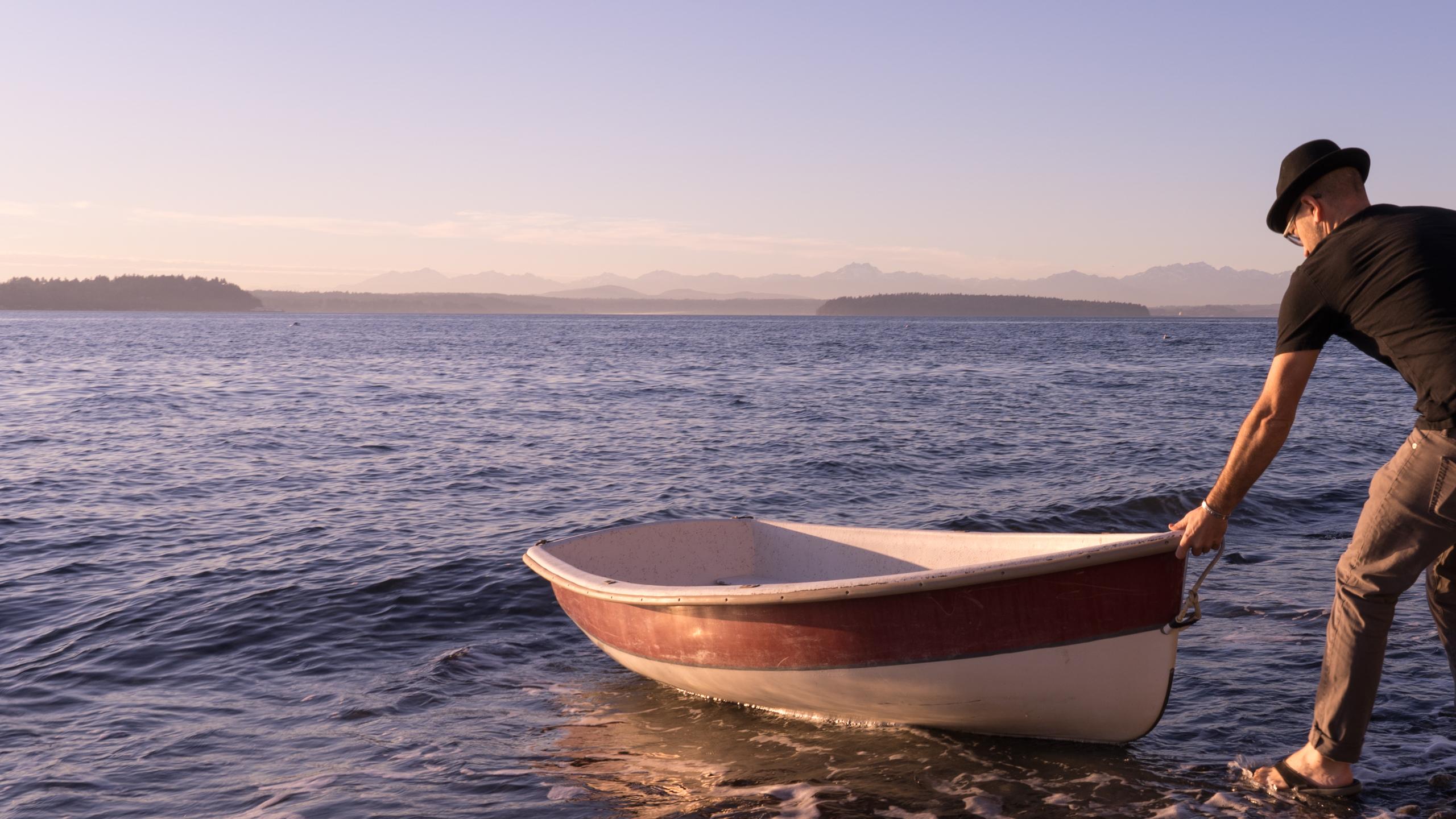 Trevor Ras launching row boat