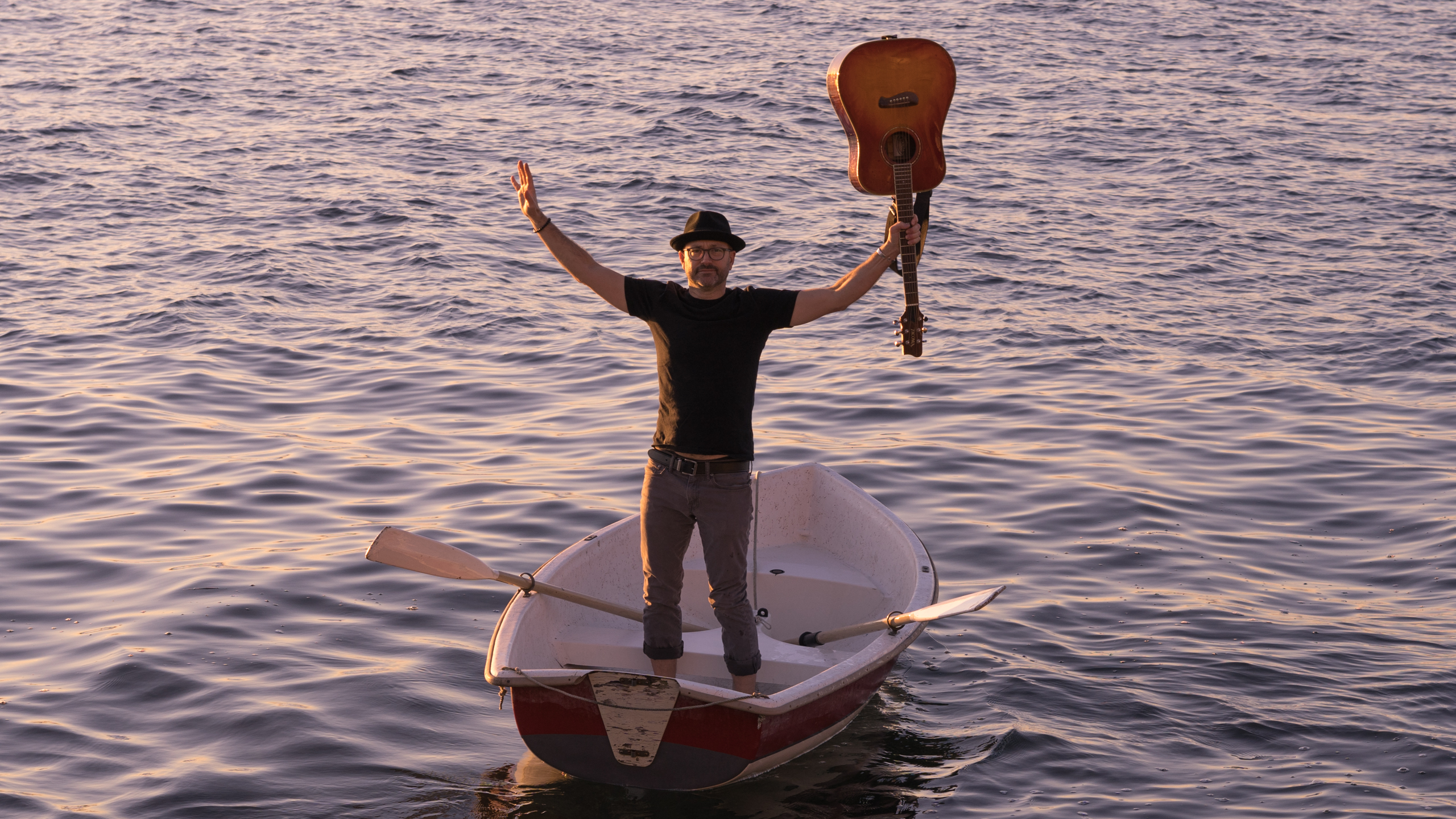 Trevor Ras in row boat