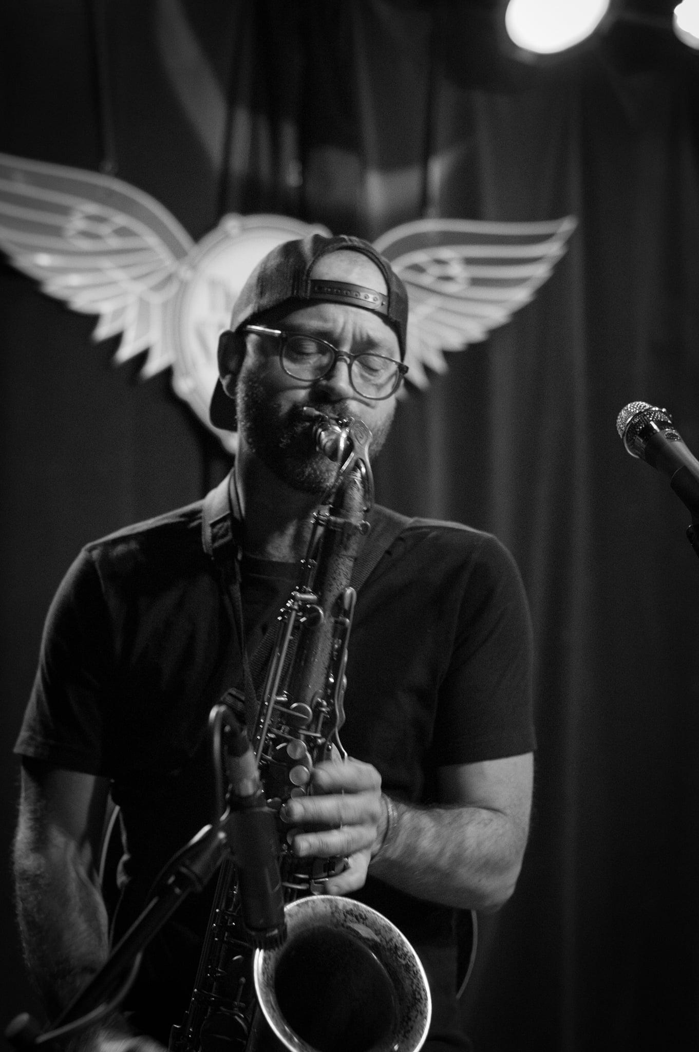 Trevor Ras playing saxophone at Skylark Cafe