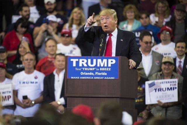 "Jabin Botsford/Washington Post via Getty Trump ""reacting to"" a protester at a campaign rally."