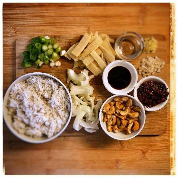 Bowls and chopping board w/ ingredients for Lao Gan Ma Rice.