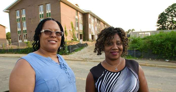 Cynthia Eaglin and Rufaro Jenkins in front of their former home at Parkway Overlook Apartments in Washington, D.C.