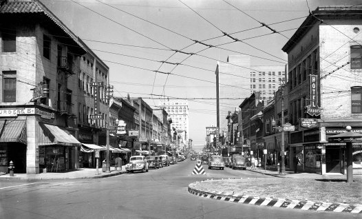 Elm Street in downtown Greensboro was the city's first restaurant row. In 1949, Minas Dascalakis got his first restaurant job at the Princess Café, one of about 75 eateries owned by members of the city's Greek community. This shot, taken from Hamburger Square in 1941, shows Jim's Lunch on the left, now the Idiot Box, and the California Sandwich Shop, now Natty Greene's, on the right.