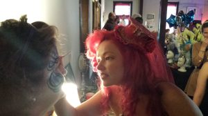 World champion bodypainter Madelyn Greco shares her skills with a friend at the Listening Loft in Reidsville.