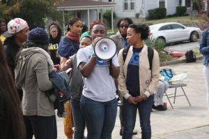 Alexis Anderson leads a chant (photo by Jariana Olukoga)
