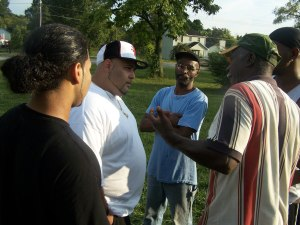 Jay and Hype (left) talking to residents at a community event.