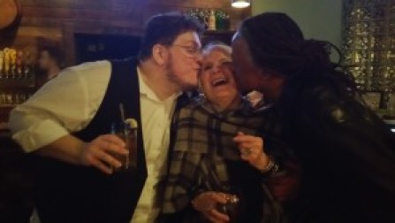 Bassist Vattel Cherry and Kernodle share a smooch with director Brenda Schleunes.