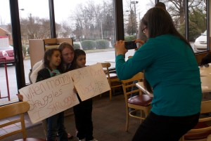 Crystal Price and her kids at a protest against her firing from a Greensboro Wendy's after Price's union activity.