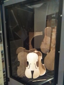 This fiddle represents the multiple stages of a luthier's craftspersonship.