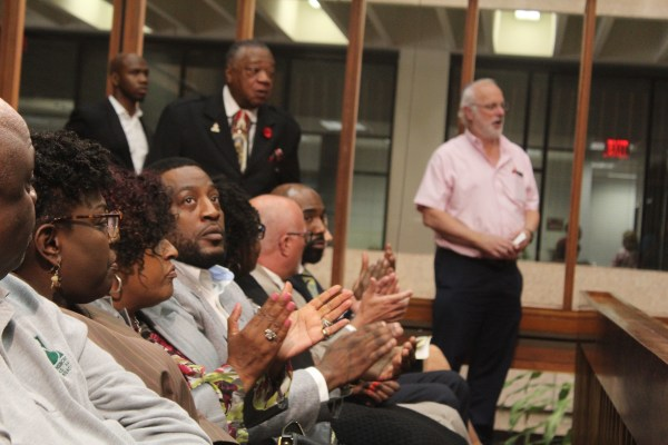 Dejuan Yourse, seated facing camera, at the special council meeting on Monday.