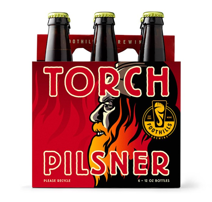 The Torch Pilsner viking has flames in his beard.