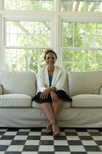 melissa-harris-perry-sitting-on-a-couch-and-smiling