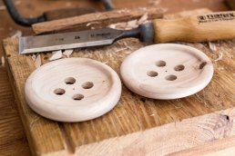 two giant wooden buttons