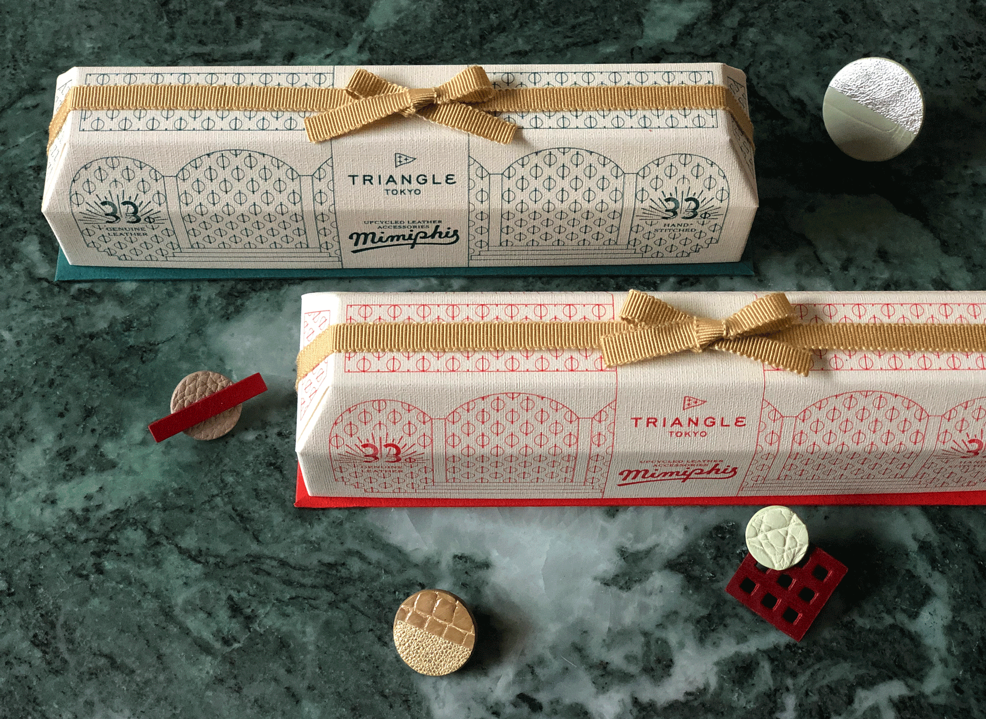 Christmas gift boxes for the leather accessories Mimiphis are on the green marble stone