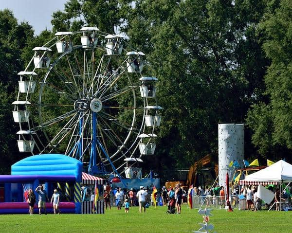ferris wheel and inflatable a Destination Dix at Dix Park in Raleigh