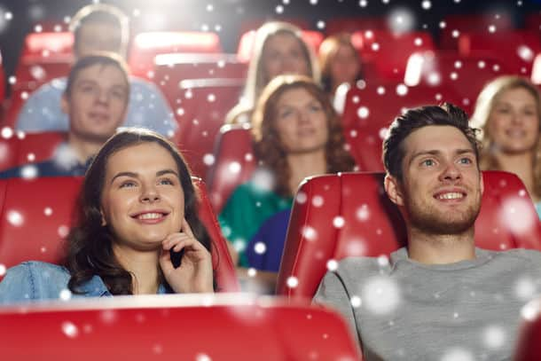 Cinema Entertainment And People Concept Happy Friends Watching Movie In Theater With Snowflakes